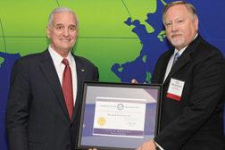 Delkor receiving an award