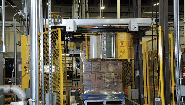 After bottles are case packed, they are conveyed to the palletizer, wrapped in plastic and trucked to a warehouse.