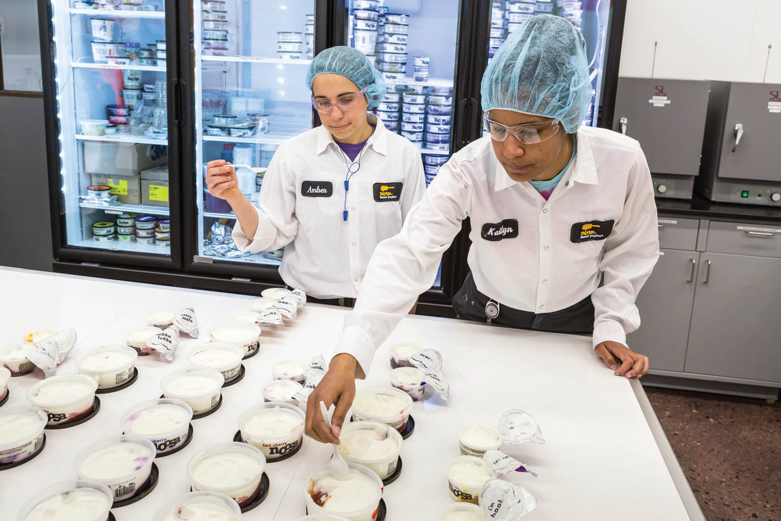 Lab technicians perform sensory evaluations of yogurts pulled from the production line.