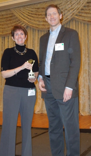 Dairy Foods' Amy Vodraska presents award to Bill Hayes, Sensient Flavors