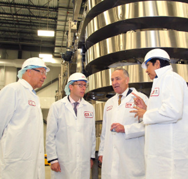PepsiCo and Theo Muller Group open Muller Quaker Dairy Yogurt Manufacturing Facility. U.S. Senator Chuck Schumer joins PepsiCo CEO Indra Nooyi on a tour of the new facility.