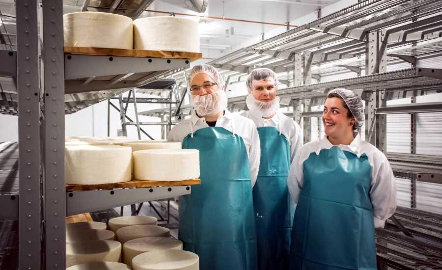 David Rogers, Dan Flavin and Alyssa Stone stand inside the Standard Market cheese cave