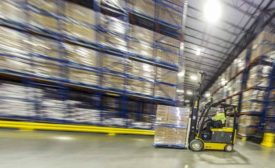 Forklift operator in a warehouse photo by Vito Palmisano for Dairy Foods